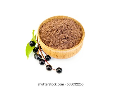 Flour bird cherry in a bowl with black berries isolated on white background