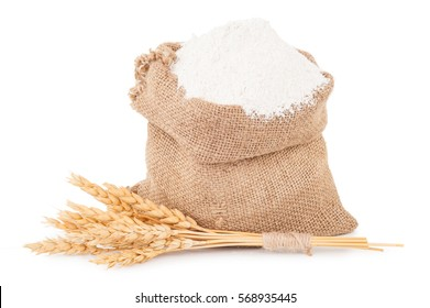 Flour in burlap bag with bunch of dry ears