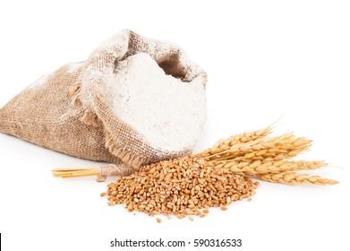 Flour in burlap bag with wheat ears