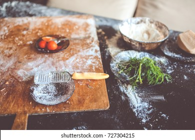 flour, cutting board and greens, creative mess in the kitchen after cooking, toning and selective focus