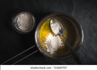 Flour in melted butter for roux cooking