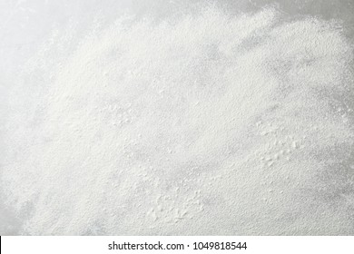 Flour on light grey background, top view
