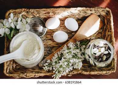 flour powder and bakery ingredients on wooden background