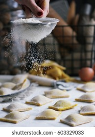 Flour process. Ravioli in the making.Ravioli with mushrooms