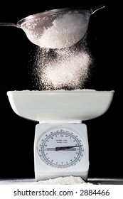 Flour sifted onto scales