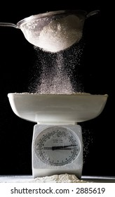 flour sifted onto scales (side lit)