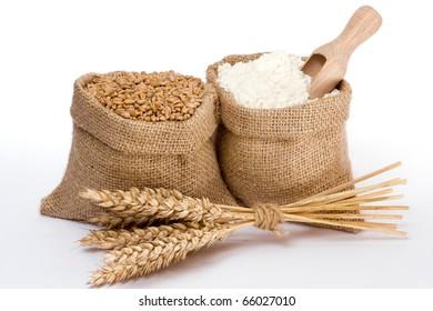Flour and wheat grain in small burlap sacks