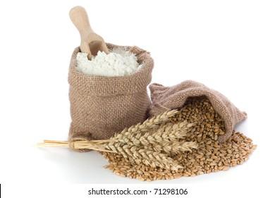 Flour and wheat grain in small canvas sacks