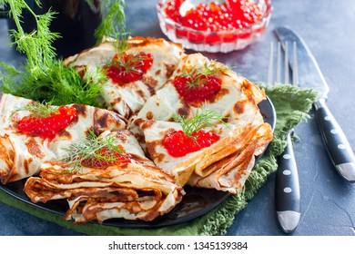Flour-free pancakes, gluten-free, low-carb with red caviar, horizontal