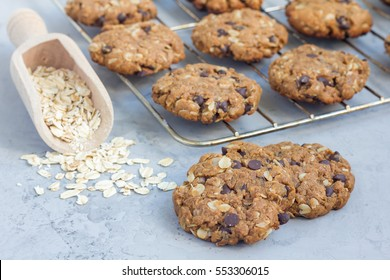 Flourless gluten free peanut butter, oatmeal and chocolate chips cookies on cooling rack, horizontal