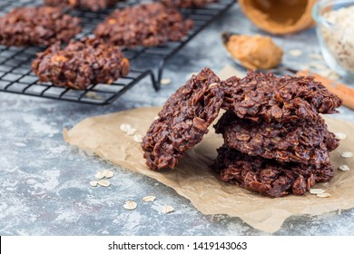 Flourless no bake peanut butter and oatmeal chocolate cookies on a parchment, horizontal, copy space