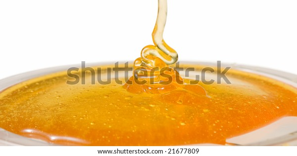 Flow of the honey on white background