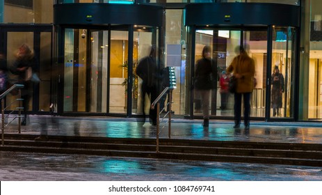 the flow of people passing through the revolving door of the office building at the end of the working day
