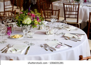 flower arangement at a wedding event - Bouquet of flowers on a table set for fine dining during a wedding