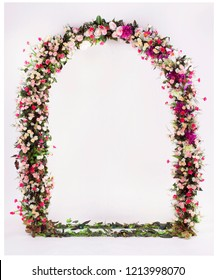 flower arch with flowers, branches and leaves