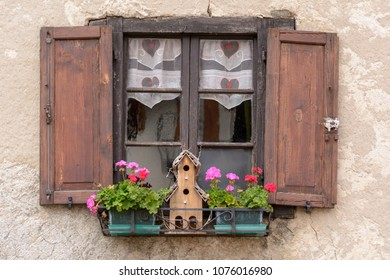 Flower Arragement on the windows of an Alpine house in Trentino-Alto Adige/Südtirol region , Italy
