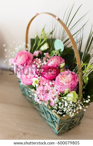 Flower arrangement basket dark light pink stock photo edit now flower arrangement in basket with dark and light pink ranunculus and austeria view from above with mightylinksfo