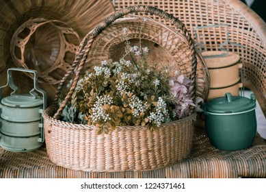 flower arrangement in baskets with old kitchen equipment.