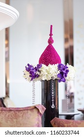 Flower arrangement. A beautiful & delicate flower decorations made of exotic Orchids and Globe Amaranth (Bachelor Button Flowers) for hotel reception. the art of flower garland arrangement soft focus