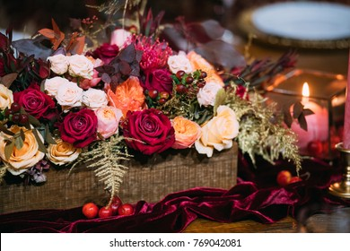 Flower arrangement with candles