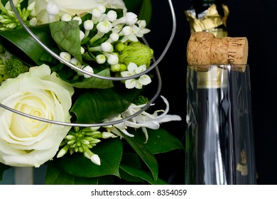 flower arrangement and a champagne bottle and glass