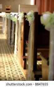 Flower arrangement in a church on side of pew