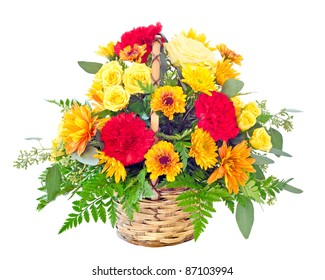 Flower arrangement with fall color carnations and daisies in basket