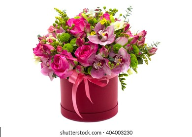 Flower arrangement in a hat box , a pot of pink for a girl on a gift with roses , orchids , freesia on a white background