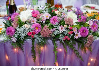 flower arrangement on a festive wedding table a bouquet of flowers on a festive table in the restaurant wedding decor and decoration