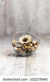 Flower arrangement on wooden desk