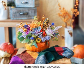 flower arrangement in pumpkin