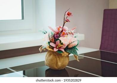 flower arrangement in vase on table. Beautiful interior.