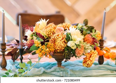 flower arranging, fall, decor concept. stunning autumnal bouquet created with different flowers such as chrisantemum presented in few types, ballet pink roses, orange calyx of groundcherries