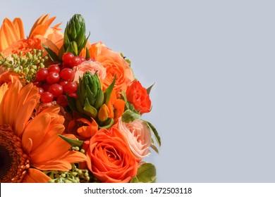 A flower autumn colors with autumn red berries of viburnum,orange gerbera,berries of eucalyptus, orange Ornithogalum, orange bouquet roses of the Alegria variety,cream bush rose of the Jana.Copy space