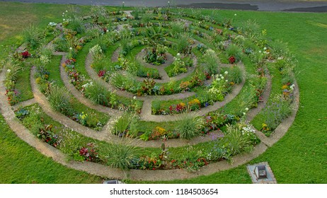 Flower bed in concentric circles in a lawn, high angle view, found alont the old city walls of Boulogne sur mer, Oise, France
