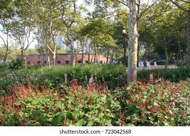 flower bed garden in Battery Park, circular fort Castle Clinton in the background