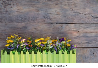a flower bed near the wall