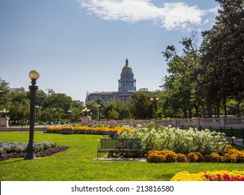 Flower beds and gardens of Civic Center Park with the gold leaf covered dome of State Capitol of Colorado in background