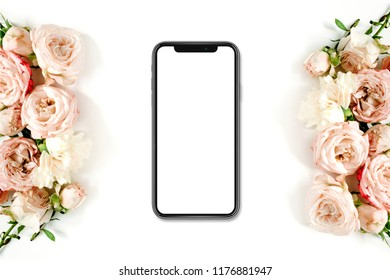 Flower border frame made of beige roses, mock up screen new version od smartphone xs on white background. Flat lay, top view.