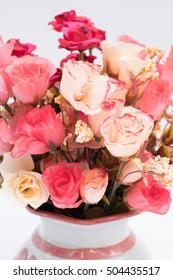 flower bouquet in glass vase on white background