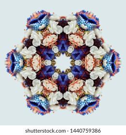 Flower bouquet mandala isolated on white background. Kaleidoscope effect.