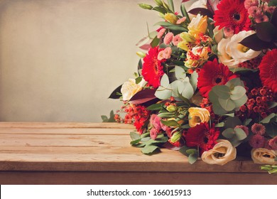 Flower bouquet on wooden table