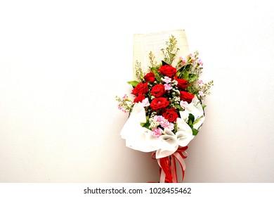 Flower bouquet over wall.
