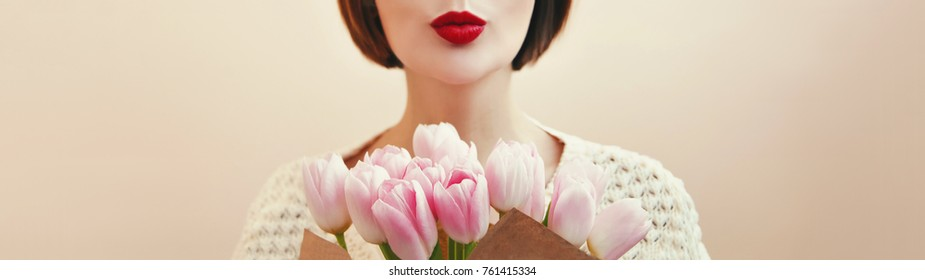 Flower bouquet present. 8 march,Mother Day celebration& Spring girl holding tulips and send kiss