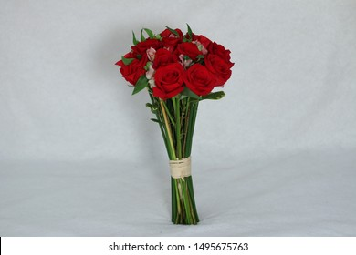 Flower bouquet with red roses.