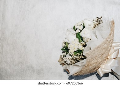 Flower bouquet from white roses isolated on white background. Closeup. Vintage toned photo