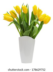 Flower bouquet from yellow tulips in vase isolated on white background. Closeup.