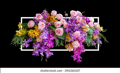 Flower bush of pink roses and tropical orchids flowers with green leaves foliage floral arrangement nature wedding or Valentines day backdrop with white frame on black background.