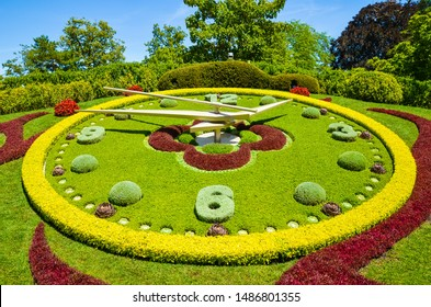Flower clock in Geneva, Switzerland. L'horloge fleurie in French, outdoor flower clock located on the western side of Jardin Anglais park. Created in 1955 as a symbol of the city's watchmakers