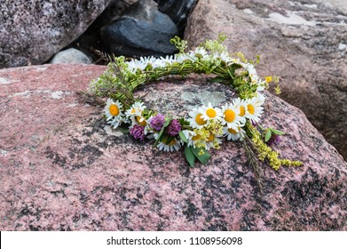 The Flower Flower Crown is placed on the coastal stones. Summer Solstice Day - Midsummer Day. Ligo night. Natural background.